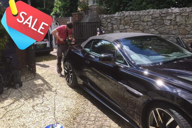 a car being machines polished in a drive way